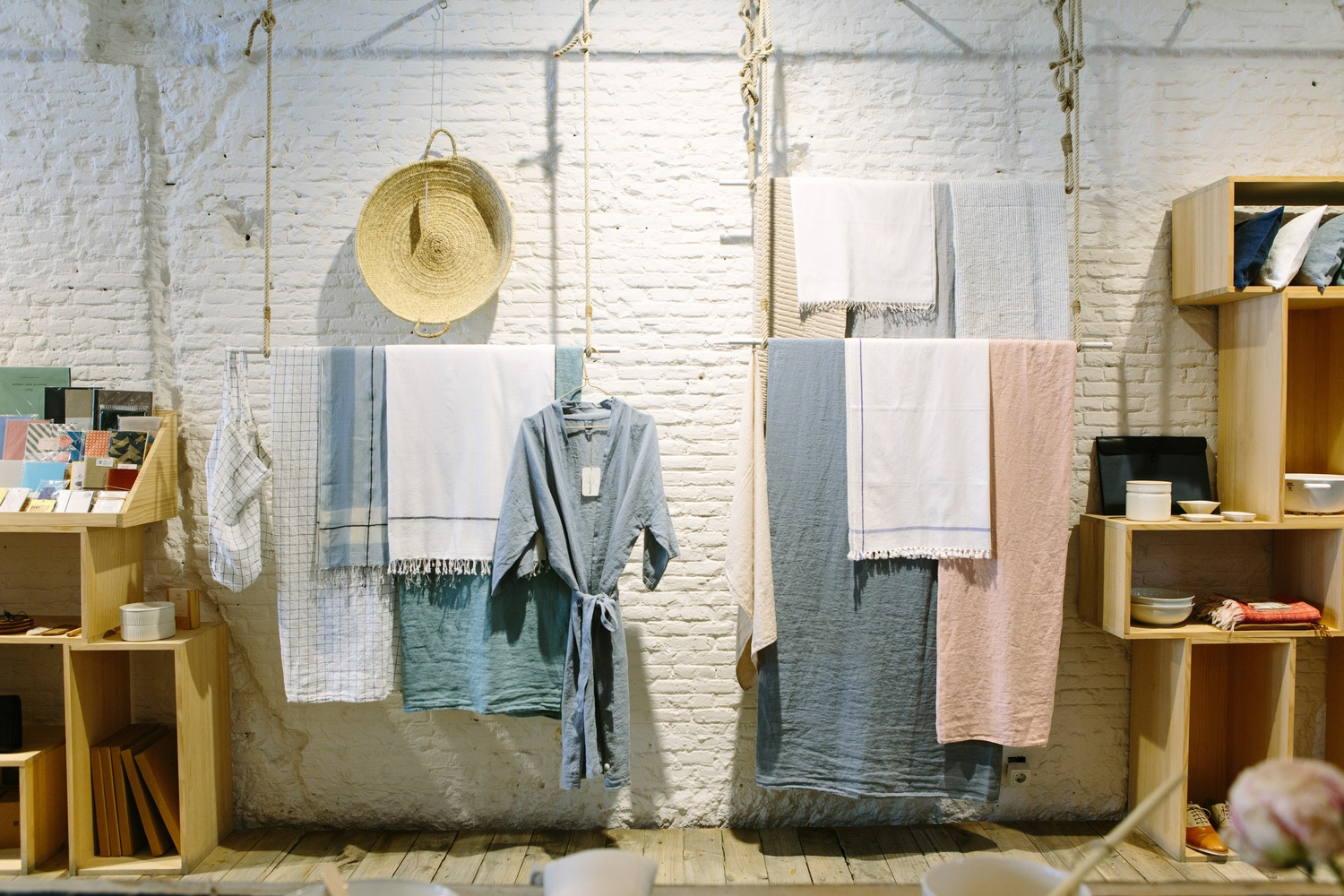 Towels and clothes hanging from a ceiling in an artistic interior - Möbel Preiss